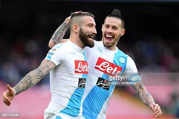 Napoli's Italian defender Lorenzo Tonelli celebrates after scoring with teammate Napoli's Slovakian midfielder Marek Hamsik during the Italian Serie...