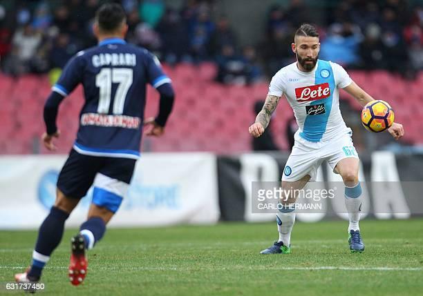 Napoli's Italian defender Lorenzo Tonelli controls the ball during the Italian Serie A football match between SSC Napoli and Delfino Pescara on...