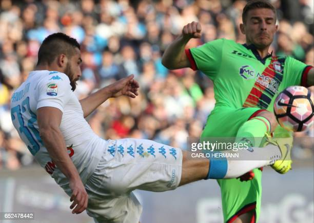 Napoli's Italian forward Leonardo Pavoletti fights for the ball with Crotone's Italian midfielder Leonardo Capezzi during the Italian Serie A...