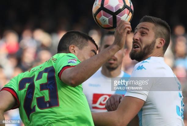 Napoli's Italian forward Leonardo Pavoletti fights for the ball with Crotone's Belgian defender Noe Dussenne during the Italian Serie A football...