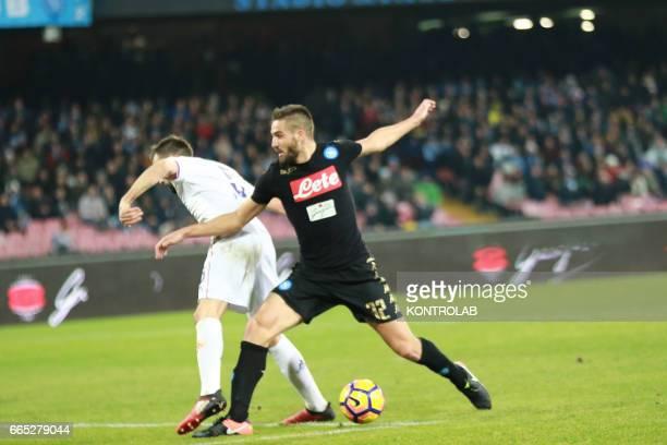 Napoli's Italian forward Leonardo Pavoletti vies with Fiorentina's Croatian forward Nikola Kalinic during the Italian Tim Cup roud of 8 football...