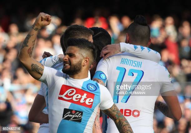 Napoli's Italian forward Lorenzo Insigne celebrates a goal by teammate Napoli's Belgian forward Dries Mertens during the Italian Serie A football...