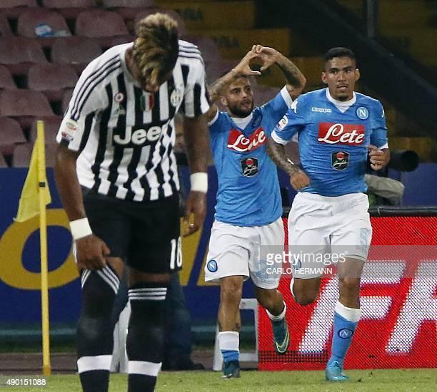 Napoli's Italian forward Lorenzo Insigne celebrates after scoring during the Italian Serie A football match SSC Napoli vs FC Juventus on September 26...