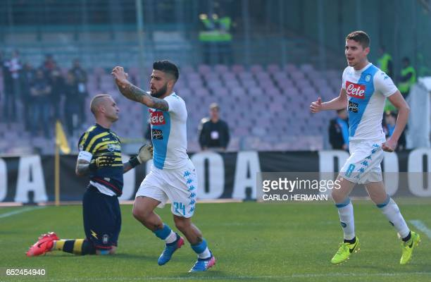 Napoli's Italian forward Lorenzo Insigne celebrates after scoring during the Italian Serie A football match SSC Napoli vs FC Crotone on March 12 2017...