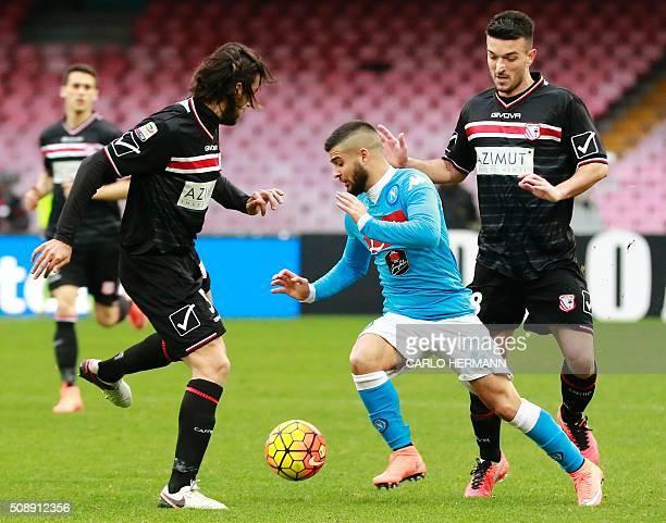 Napoli's Italian forward Lorenzo Insigne fights for the ball with Carpi's Italian defender Cristian Zaccardo and Carpi's Italian midfielder Raffaele...