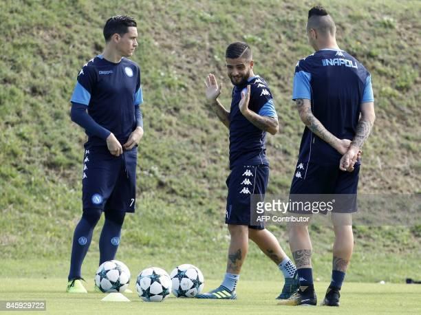 Napoli's Italian forward Lorenzo Insigne gestures near Napoli's Spanish forward Jose Maria Callejon and Napoli's Slovakian midfielder Marek Hamsik...