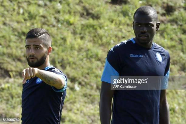 Napoli's Italian forward Lorenzo Insigne gestures next to Napoli's French defender Kalidou Koulibaly take part in a training session on the eve of...