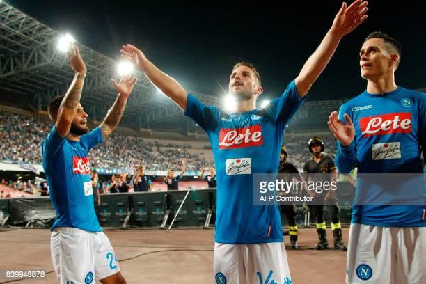 Napoli's Italian forward Lorenzo Insigne Napoli's Belgian forward Dries Mertens and Napoli's Spanish forward Jose Maria Callejon celebrate at the end...