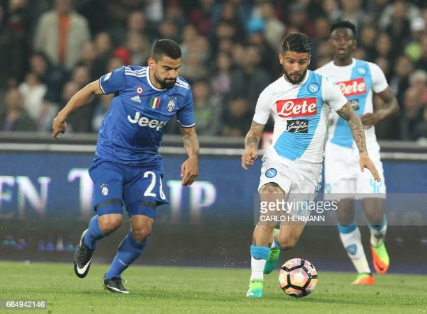 Napoli's Italian forward Lorenzo Insigne vies with Juventus' midfielder from Venezuela Tomas Rincon during the Tim Cup semifinal second leg football...