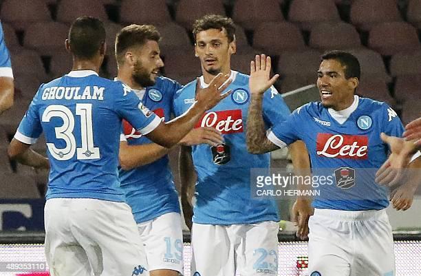 Napoli's Italian forward Manolo Gabbiadini celebrates with teammates after scoring during the Italian Serie A football match SSC Napoli vs SS Lazio...