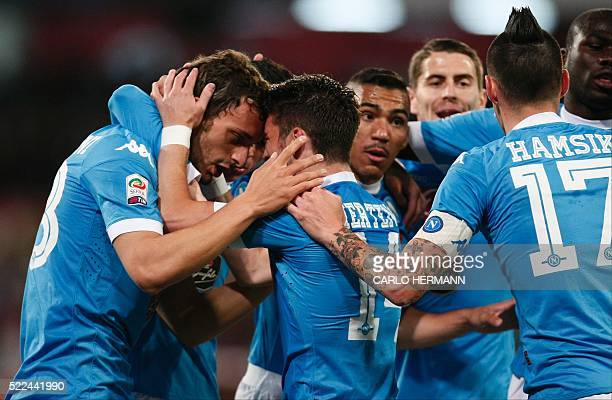 Napoli's Italian forward Manolo Gabbiadini celebrates with teammates after scoring during the Italian Serie A football match SSC Napoli vs Bologna FC...