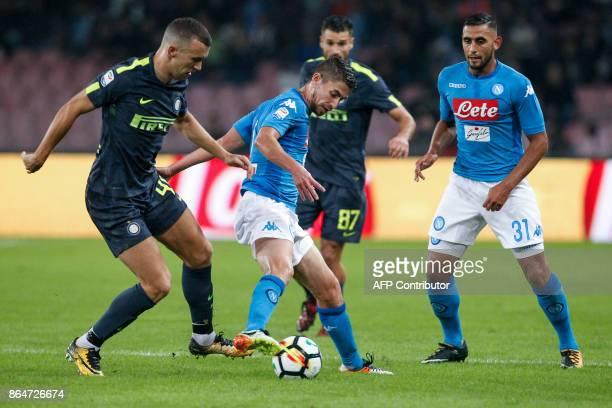 Napoli's Italian midfielder Brazilianborn Jorginho controls the ball as fighting with Inter Milan's Croatian midfielder Ivan Perisic next to teammat...