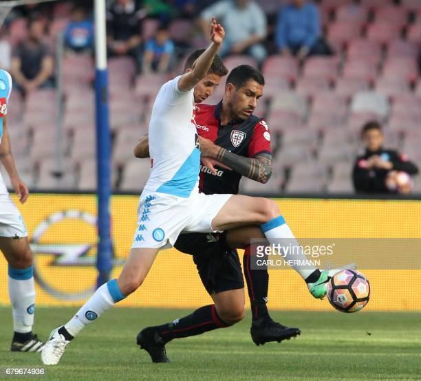 Napoli's Italian midfielder Brazilianborn Jorginho fights for the ball with Cagliari's Italian forward Marco Borriello during the Italian Serie A...