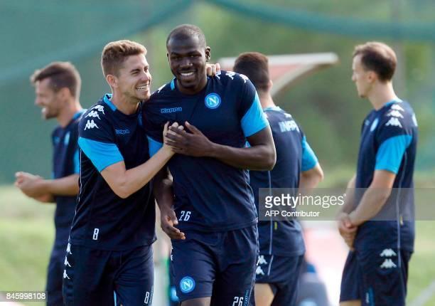 Napoli's Italian midfielder Brazilianborn Jorginho jokes with Napoli's French defender Kalidou Koulibaly during a training session on the eve of the...