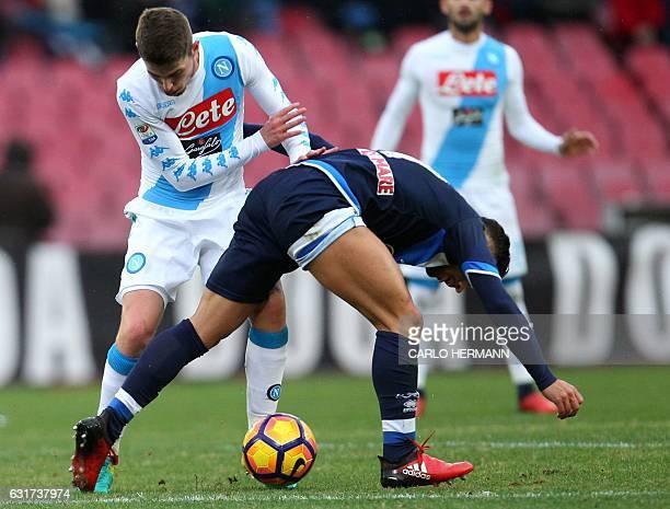 Napoli's Italian midfielder Jorginho fights for the ball with Pescara's Italian forward Gianluca Caprari during the Italian Serie A football match...