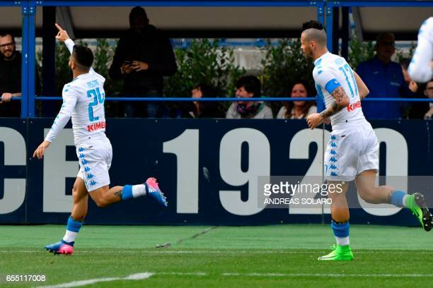 Napoli's Italian midfielder Lorenzo Insigne celebrates after scoring a goal during the Italian Serie A football match between Empoli and Napoli on...