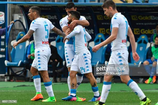 Napoli's Italian midfielder Lorenzo Insigne celebrates with his teammates after scoring during the Italian Serie A football match Empoli versus...