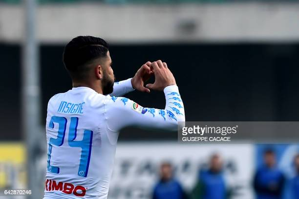 Napoli's Italian midfielder Lorenzo Insigne makes a heart with his hands as he celbrates after scoring a goal during the Italian Serie A football...