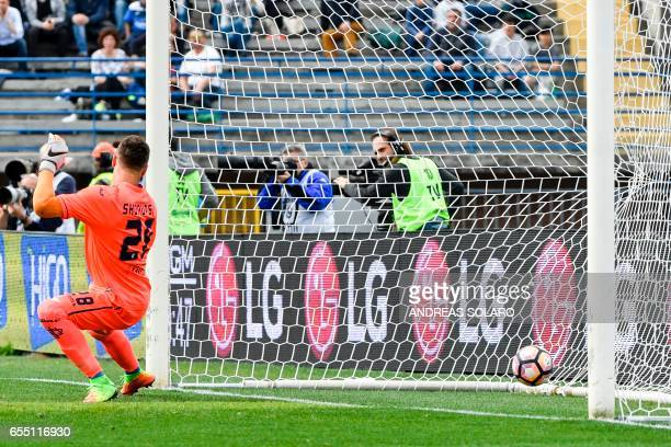 Napoli's Italian midfielder Lorenzo Insigne shoots and scores during the Italian Serie A football match between Empoli and Napoli on March 19 2017 at...