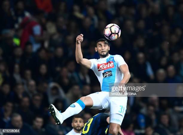 Napoli's Italian striker Leonardo Pavoletti heads the ball during the Italian Serie A football match between Inter Milan and Napoli at the San Siro...