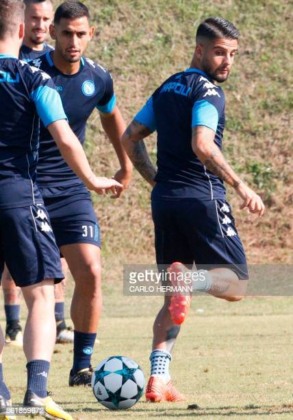 Napoli's Italian striker Lorenzo Insigne attens a training session on the eve of the UEFA Champions League Group F football match Manchester City vs...