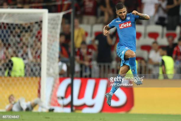 Napoli's Italian striker Lorenzo Insigne celebrates after scoring a goal during the UEFA Champions League playoff football match between Nice and...