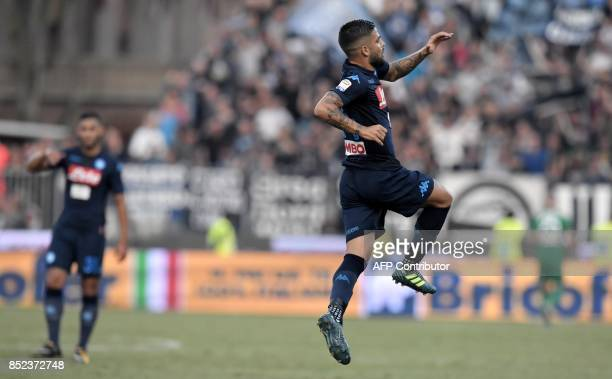 Napoli's Italian striker Lorenzo Insigne celebrates after scoring a goal during the Serie A football match between Spal and Napoli at Paolo Mazza...