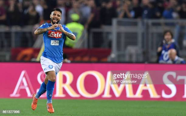 Napoli's Italian striker Lorenzo Insigne celebrates after scoring during the Italian Serie A football match AS Roma vs Napoli at the Olympic Stadium...