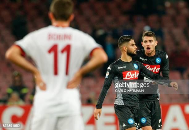 Napoli's Italian striker Lorenzo Insigne celebrates celebrates with teammate Napoli's Italian midfielder Jorginho after scoring during the Italian...