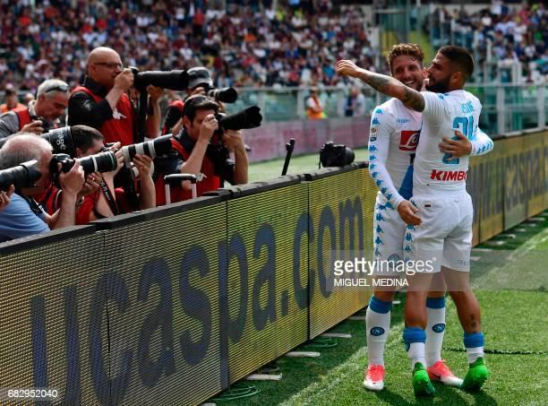 Napoli's Italian striker Lorenzo Insigne celebrates with Napoli's Belgian striker Dries Mertens after scoring during the Italian Serie A football...