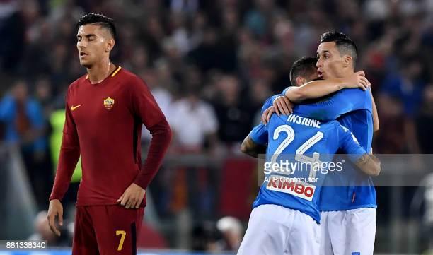 Napoli's Italian striker Lorenzo Insigne celebrates with teammate Napoli's midfielder from Spain Jose Maria Callejon after scoring during the Italian...