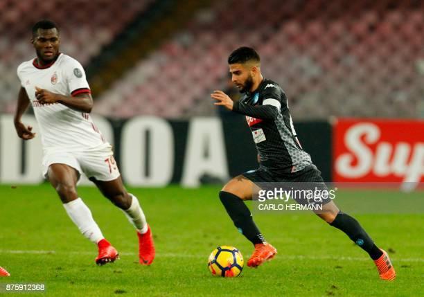 Napoli's Italian striker Lorenzo Insigne controls the ball next to Milan's Ivorian midfielder Franck Kessie during the Italian Serie A football match...