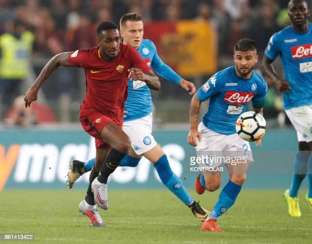 OLIMPICO ROME LAZIO ITALY Napoli's Italian striker Lorenzo Insigne fights for the ball with Roma's Brazilian midfielder Gerson during the Italian...
