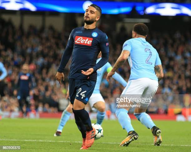 Napoli's Lorenzo Insigne reacts after losing the ball to Manchester City defenders during the Champions League group F soccer match between...