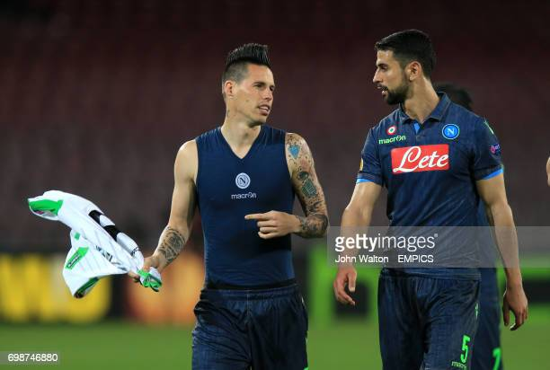 Napoli's Marek Hamsik and Miguel Britos walk off celebrating their progress into the next round of the competition