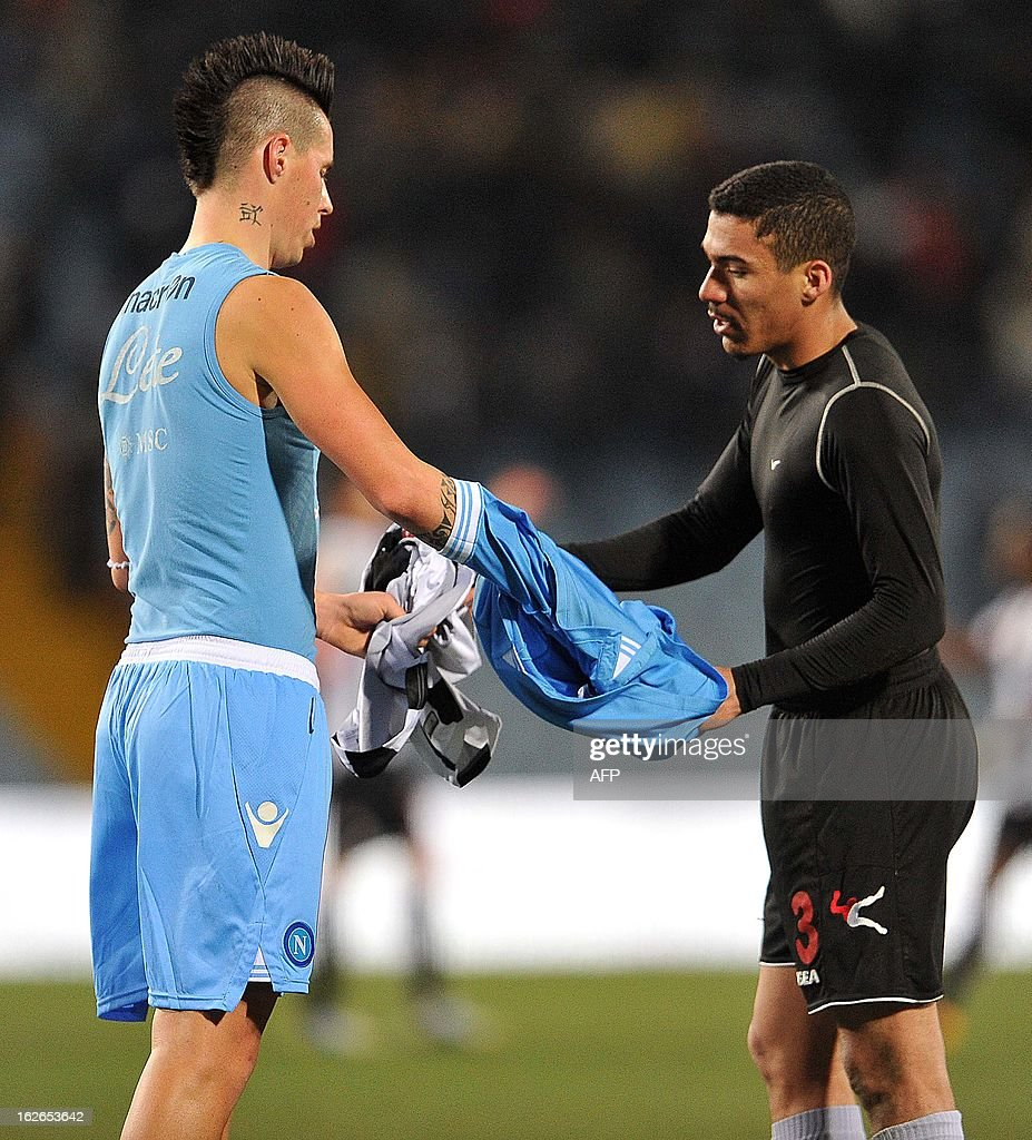 Napoli's Marek Hamsik exchanges jerseys Udinese's Marques Loureiro Allan (R) during the Serie A football match Udinese vs Napoli at Friuli Stadium in Udine on February 25, 2013. AFP PHOTO / SIMONE FERRARO