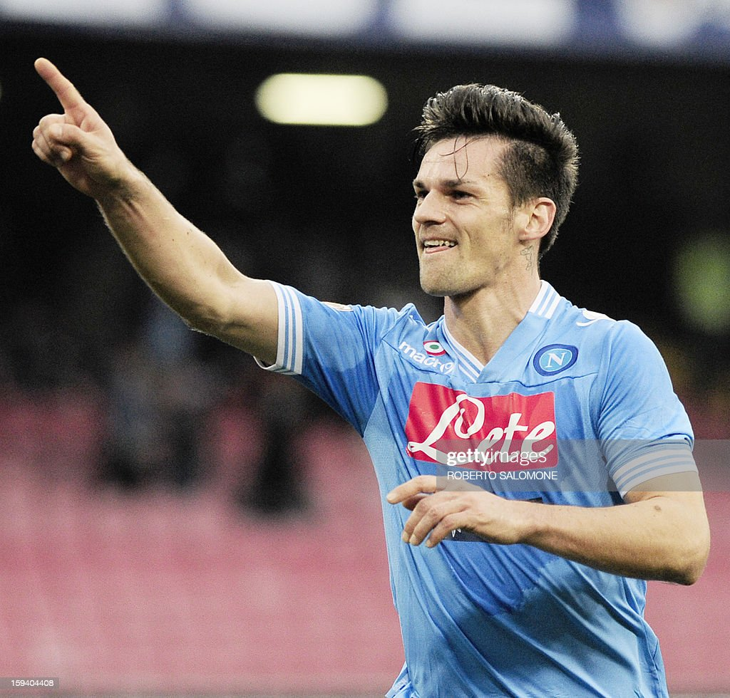 SSC Napoli's midfielder Christian Maggio celebrates after scoring a goal during an Italian Serie A football match SSC Napoli vs US Palermo at San Paolo Stadium in Naples on January 13, 2013.