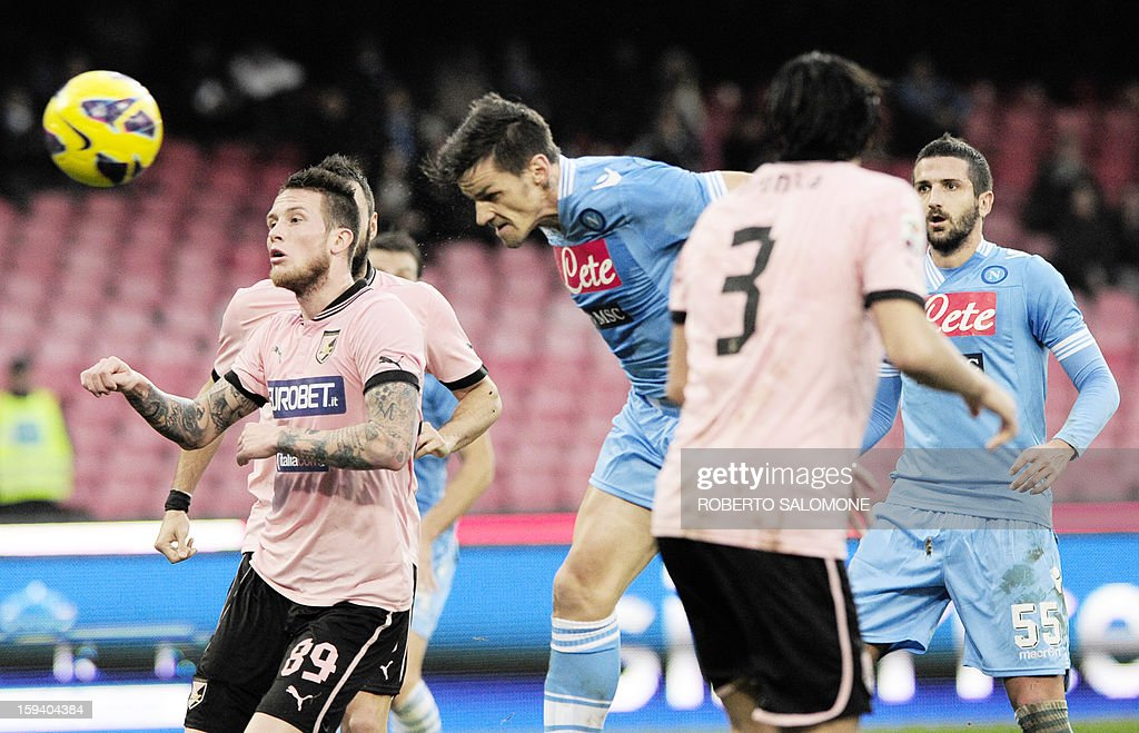 SSC Napoli's midfielder Christian Maggio (C) heads the ball during an Italian Serie A football match SSC Napoli vs US Palermo at San Paolo Stadium in Naples on January 13, 2013.