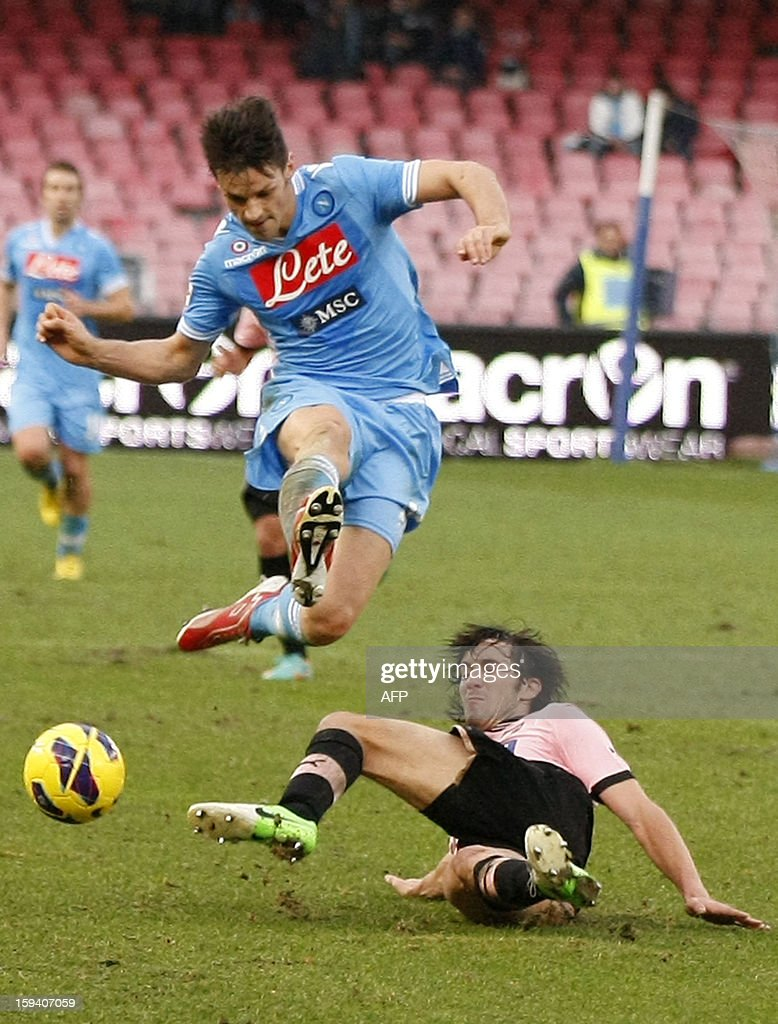 Napoli's midfielder Christian Maggio (L) vies for the ball with Palermo's defender Santiago Garcia during the Italian Serie A football match SSC Napoli vs US Palermo won by SSC Napoli 3-0 at San Paolo Stadium in Naples on January 13, 2013.