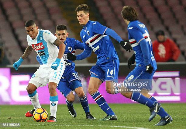 Napoli's midfielder from Brazil Allan fights for the ball with Sampdoria's forward from Czech Republic Patrik Schick during the Italian Serie A...