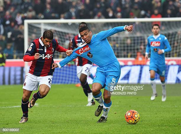 Napoli's midfielder from Brazil Allan vies with Bologna's forward from Italy Franco Brienza during the Italian Serie A football match Bologna vs...