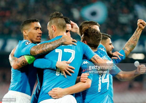 Napoli's midfielder from Brazil Jorginho celebrates with teammates after scoring during the UEFA Champions League football match Napoli vs Manchester...
