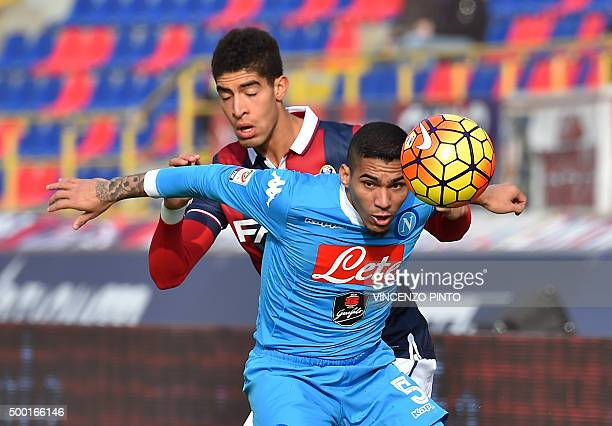Napoli's midfielder from Brazil Marques Loureiro Allan in action with Bologna's defender from Morocco Adam Masina during the Italian Serie A football...