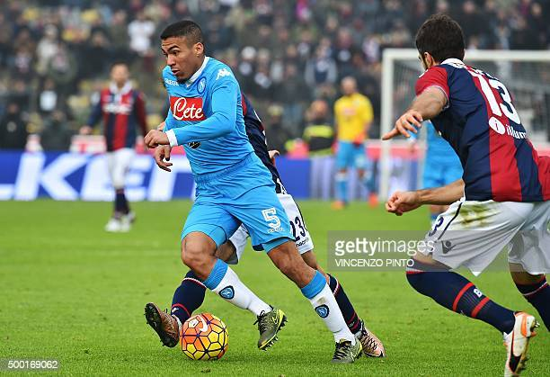 Napoli's midfielder from Brazil Marques Loureiro Allan vies with Bologna's defender from Italy Luca Rossettini during the Italian Serie A football...