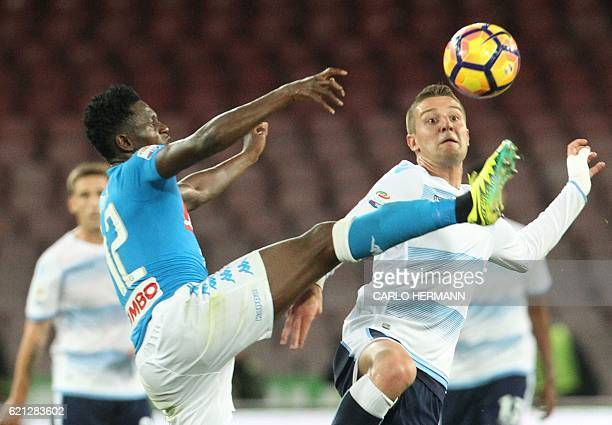 Napoli's midfielder from Guinea Amadou Diawara vies for the ball with Lazio's midfielder from Serbia Sergej MilinkovicSavic during the Italian Serie...