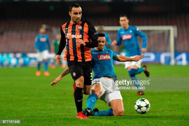 Napoli's midfielder from Italy Christian Maggio fights for the ball with Shakhtar Donetsk's Brazilian defender Ismaily during the UEFA Champions...