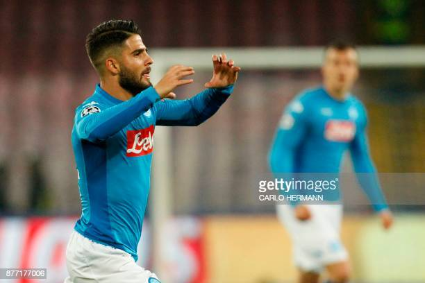 Napoli's midfielder from Italy Lorenzo Insigne celebrates after scoring during the UEFA Champions League Group F football match Napoli vs Shakhtar...