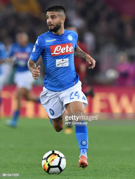 Napoli's midfielder from Italy Lorenzo Insigne controls the ball during the Italian Serie A football match Roma vs Napoli at the Olympic Stadium in...