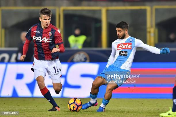 Napoli's midfielder from Italy Lorenzo Insigne fights for the ball with Bologna's midfielder Nagy Adam during the Italian Serie A football match...