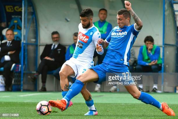 Napoli's midfielder from Italy Lorenzo Insigne fights for the ball against Empoli's midfielder from BosniaHerzegovina Rade Krunic during the Italian...